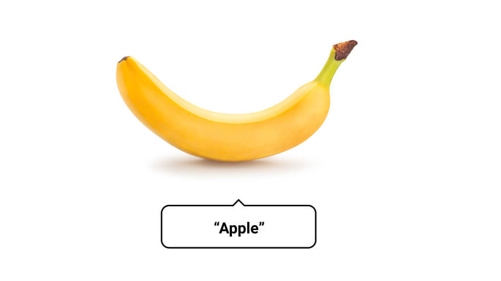 A picture of a banana with the word 'Apple' underneath, to illustrate bad alt text.